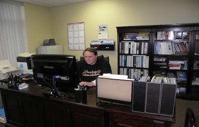 Gary Jenkins Sitting at Desk